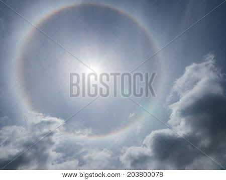 Sun halo on blue sky background natural phenomenon