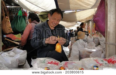 Portrait Of Vendor At Jokhang Temple In Tibet