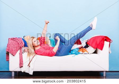 Happy Woman Lying On Messy Couch