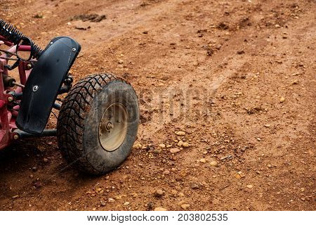 Off road buggy tire on dirt road