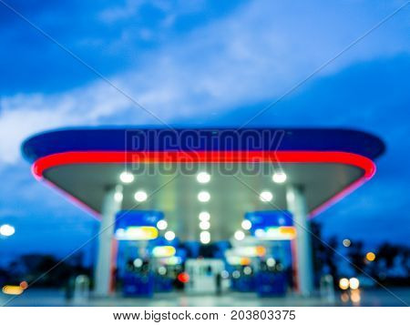 Blur image of twilight gas station during sunset.