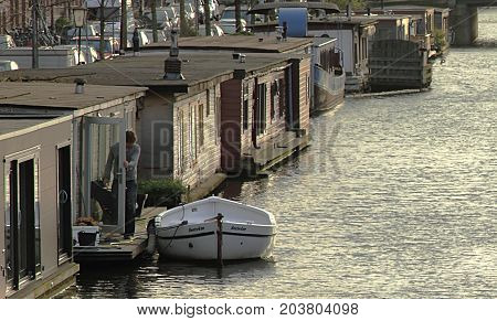Amsterdam, Netherland - April 7 2017. Houseboats on the dusk in the canal of Amsterdam