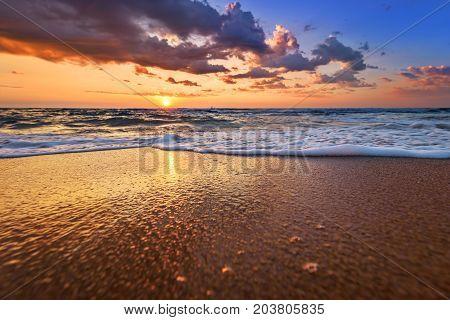 Early morning sunrise over sea. Golden sands.