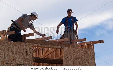 Men Build Roof For Home For Habitat For Humanity