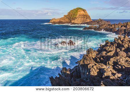 Waves and lava rocks at Porto Moniz Madeira island Portugal