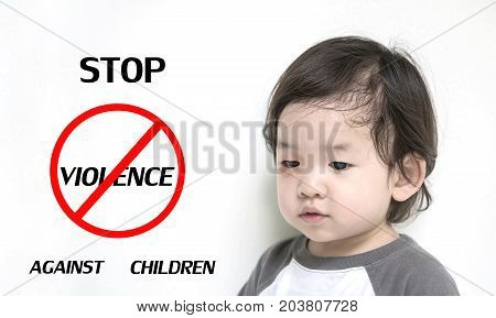 Closeup poor kid with swollen eye in stop violence against children concept