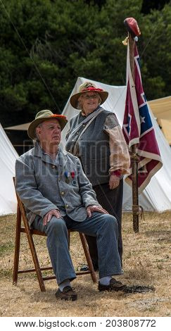 Couple Rests In Confederate Uniforms