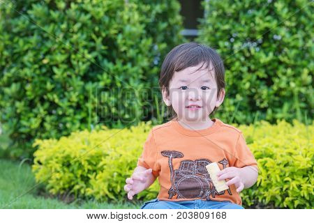 Closeup cute asian kid play in the park background