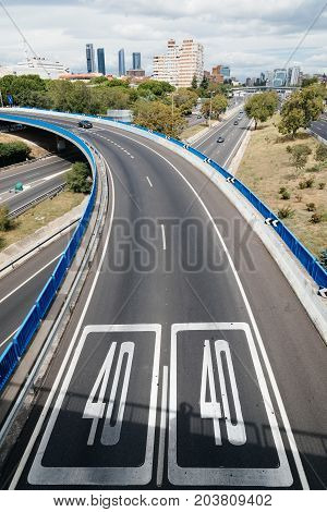 Madrid, Spain - September 9, 2017: 40 speed limit in M30 Motorway in Madrid a cloudy day.