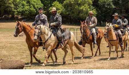 Confederate Soldiers On Horseback