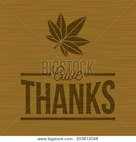 thanksgiving day poster, give thanks typographic and leaf on wooden background