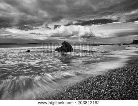Waves hitting against a rock in Ballycastle, Antrim, Northern Ireland