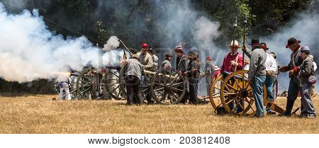 Confederate Soldiers Fire Canon