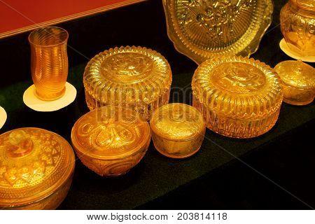 Yellow vintage glassware on display. Antiques glassware.