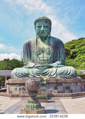 Kanagawa, Japan - June 9, 2017: Giant Buddha in Kotoku-in temple at Kamakura, Kanagawa Prefecture, Japan. This statue is a bronze statue of Amida Buddha which is one of the most famous icons of Japan.