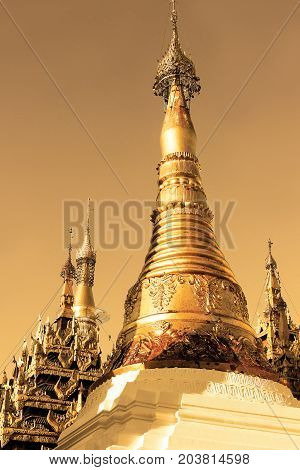 Scenic landscape of  Shwedagon Pagoda in Yangon, Myanmar at sunset. Officially named Shwedagon Zedi Daw and also known as the Great Dagon Pagoda and the Golden Pagoda