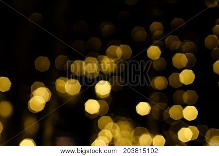 Blury gold Bokeh on black background. Abstact background.