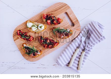 Brushetta or authentic traditional spanish tapas for lunch table. Delicious snack appetizer antipasti on party or picnic time. Top view flat lay.