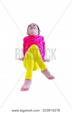 Healthy children. Adorable chinese girl in pink long sleeves shirt smiling and stretching exercises after doing yoga at studio. Fitness sport and active lifestyle. Isolated on white background.