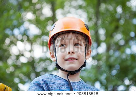 Portrait of a boy in a protective helmet.