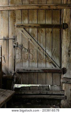 Old closed wooden door with a lock