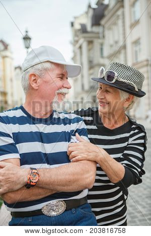 Happy Mature Man And Woman Leaned Against Each Other. Mature Man And Woman Smiling Leaning Against E