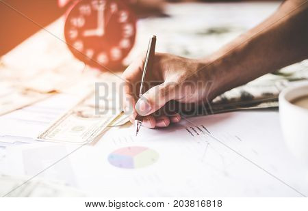 Business man  writing documents graph, report finance. Business Concept. select focus