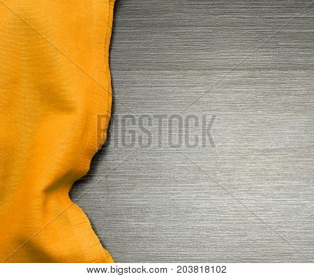 Color vibrant cloth on wooden table for background. Fabric texture. Wooden texture.Template for designers