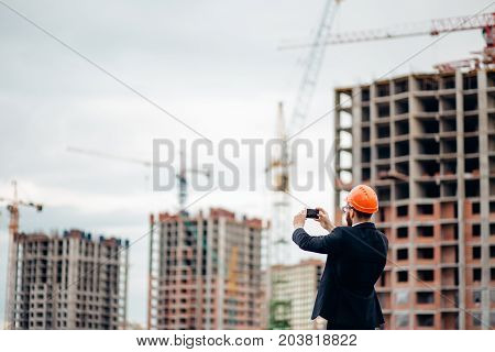 Engineer Take A Photo Of Construction Site