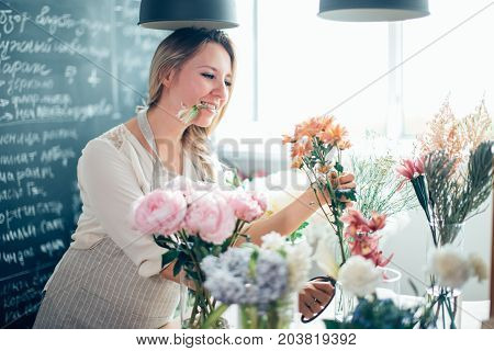 Florist Takes A Flower To Make A Bouquet