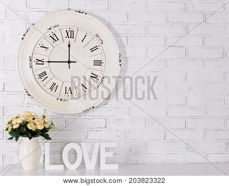 Wooden Letters Forming Word Love, Flowers And Vintage Clock Over White Brick Wall