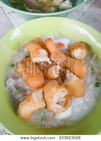Traditional Thai Porridge Rice Gruel In White Bowl Congee. In The Street Market