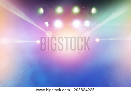 multi-colored light beams from the stage of the entertainment show. nightlife with music and entertainment abstract background with defocused bokeh light.