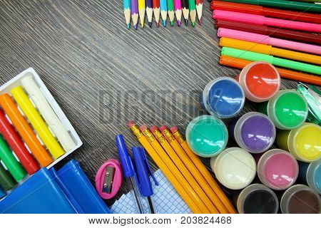 School supplies isolated  on wooden background. Schooling.