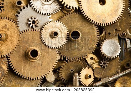 Aged gears cogwheels macro view. Steampunk mechanical equipment and mechanism background. Shabby grunge scratch metal texture. Shallow depth of field, soft focus.