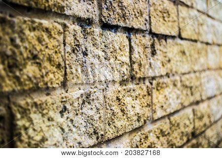 Stone wall , old , dirty showing mortar