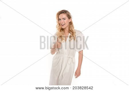 Woman In Robe Showing Thumb Up
