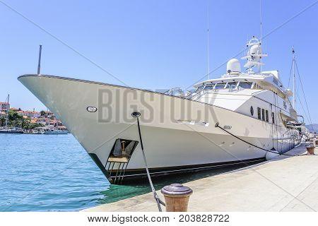 TROGIR, CROATIA - JULY 12, 2017: Huge luxury yacht parked in the water of Trogir Croatia