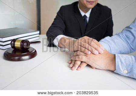 Mature male lawyer or notary with client deciding on marriage divorce in his office