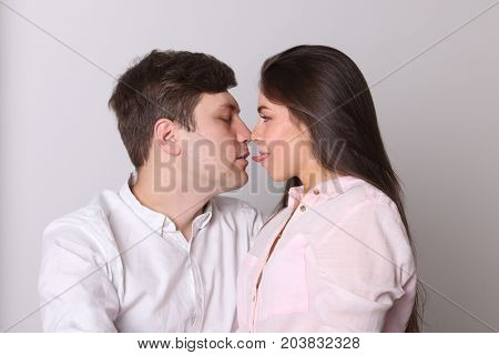 Man and woman rub their noses in room woman stuck out her tongue