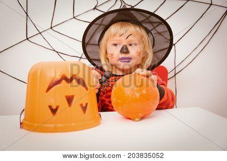 little girl prepare for Halloween party, Halloween celebration