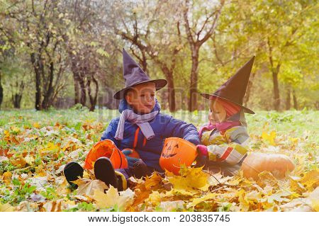 kids in halloween costume play at autumn fall nature
