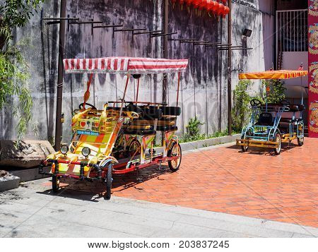 Penang Malaysia - April 24 2017: Colorful quadricycles or surrey bikes for rental in the area of UNESCO World Heritage site of George town Penang Malaysia.