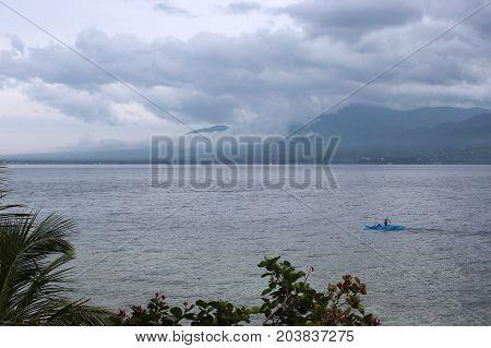 Fishermen On Canoe. Philippines
