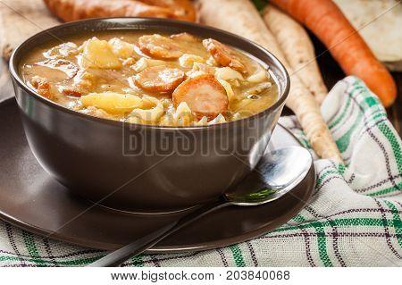 Traditional Polish Split Pea Soup With Sausage, Bacon And Potatoes