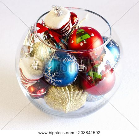 Christmas Tree Toys In A Round Glass Vase