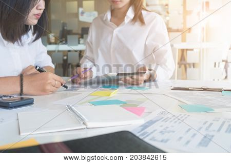 Two business woman discussing documents and ideas at meetingbusiness consulting concept.