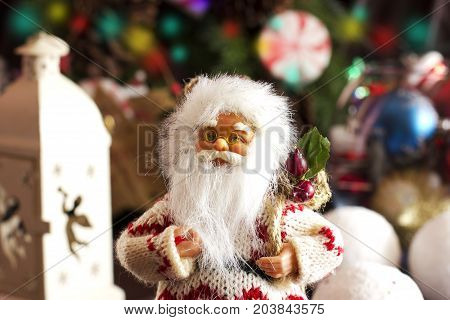 Santa Claus And Christmas Tree Toys In A Round Glass Vase