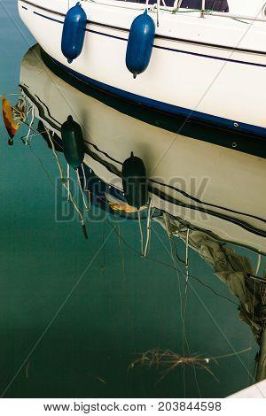 Sport Yacht Boat Side Reflecting In Water