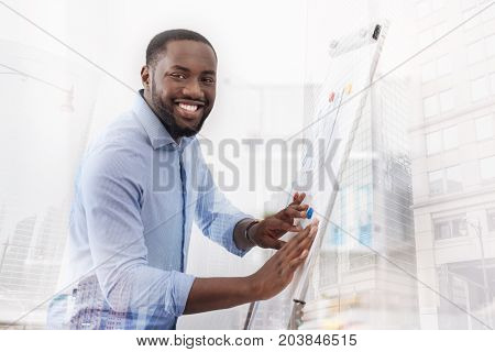Next lesson. Close up of enthusiastic student touching a magnet board with both hands while looking at you with fascination